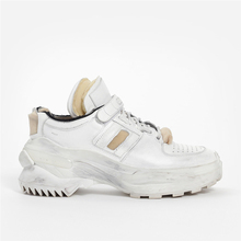 Maison Margiela/mmm old destruction of white sports shoes produced in Italy