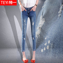 Hole in the spring and summer student slim slim Korean version of foot pants