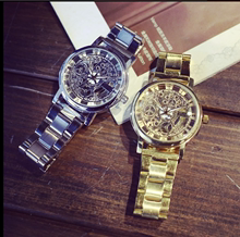 Hong Kong style local luxury gold watch women's steel band fashion fashion men's personality double-sided hollow couple non mechanical Large Dial Watch